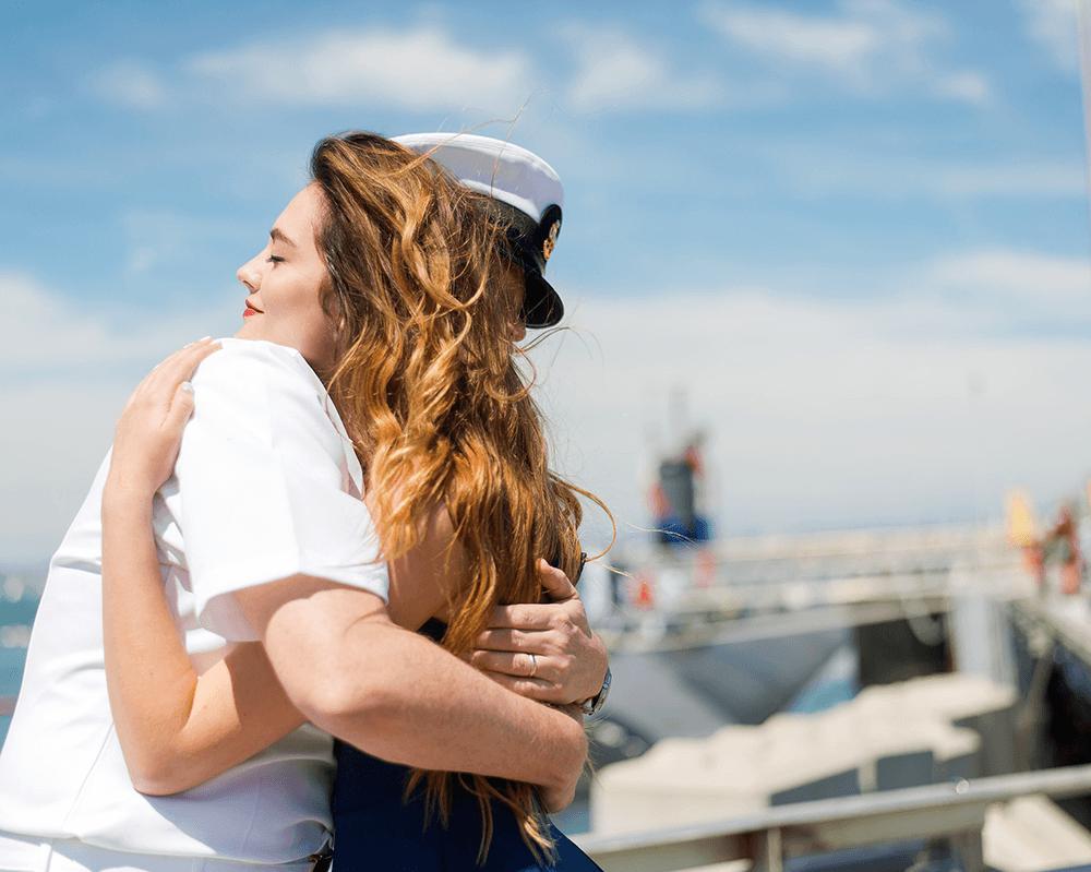 Americanna blog - Woman reuniting with veteran.